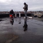 MItigation tech workers on roof